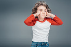 Curly little boy at studio stock photography