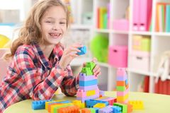 Girl playing with plastic blocks Stock Photography