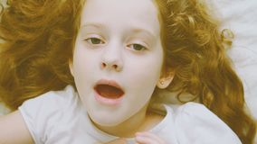 Curly little girl tells her mother `I love you`. stock video footage