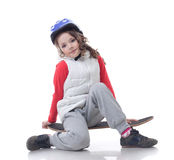 Curly little skateboarder posing at camera Royalty Free Stock Images
