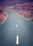 A curly long deserted road in the middle of nowhere Royalty Free Stock Photography