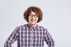 Curly nerd man in glasses with a stupid kind of funny emotion. Stock Image