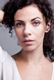 Curly noble blue-eyed woman. The Curly noble blue-eyed woman Stock Photography
