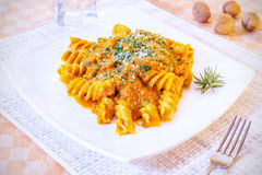 Curly pasta and pumpkin royalty free stock photo