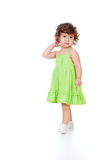 Curly pensive little girl isolated on white Royalty Free Stock Images
