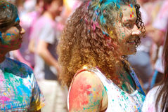Curly rainbow hair and face Spring Festival Royalty Free Stock Photo