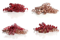 Curly red and gold ribbons on white Royalty Free Stock Photo