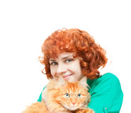 Curly red-haired girl with a red cat isolated Royalty Free Stock Photography