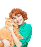 Curly red-haired girl with a red cat isolated Royalty Free Stock Photo