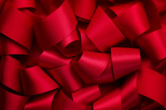 Curly red ribbon Stock Photos