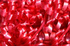 Curly Ribbon all in Red. Mass of curly red ribbon fills photo.  Many strands of curls and frills Stock Images