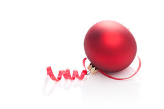 Curly ribbon and Christmas Bauble Royalty Free Stock Image