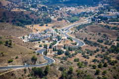 Curly road from the Mijas town to the coast Stock Photos