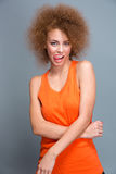 Curly seductive flirty girl showing tongue Royalty Free Stock Image
