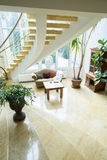 Curly stairs. Big curly stairs in spacious front room Royalty Free Stock Photo