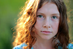Curly Teenage girl looking at the camera in sunlight Royalty Free Stock Image