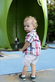Curly toddler at playground Stock Photo