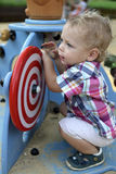 Curly toddler playing at playground Royalty Free Stock Images