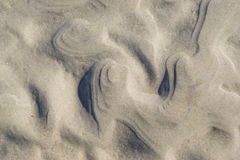 Curly, wavy  sand pattern on beach Royalty Free Stock Photography