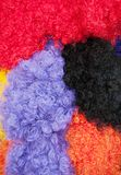 Curly wigs. Assorted brightly colored curly wigs, closeup. Very jolly Stock Photography