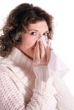 Curly woman with a cold. A nice-looking curly woman got a cold. All isolated on white background Stock Images