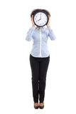 Curly woman covering face with office clock isolated on white Royalty Free Stock Photos