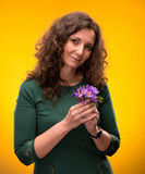 Curly woman with crocus flowers Royalty Free Stock Photo