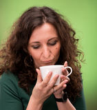 Curly woman with a cup of tea or coffee Stock Photography
