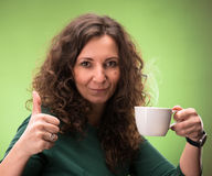 Curly woman with a cup of tea or coffee Royalty Free Stock Photos