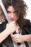 Curly woman curly girl and sword Stock Images
