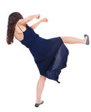 Curly woman funny fights waving his arms and legs Stock Images