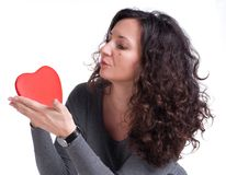 Curly woman with a heart Stock Photography
