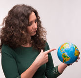 Curly woman holding a globe Stock Photography