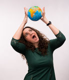 Curly woman holding a globe Stock Photo