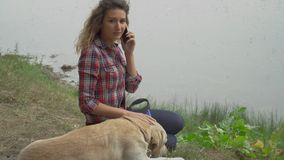 Pretty woman and dog is resting outdoor together stock video footage