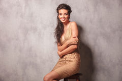 Free Curly Woman Pose Sitting On A Chair With Hands Crossed Royalty Free Stock Images - 61670859
