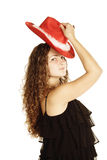Curly woman in red hat Stock Photography