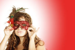 Curly woman in red mask Royalty Free Stock Image