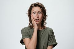 Curly woman with shocked face royalty free stock photos