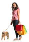 Curly woman with shopping bags and american spaniel Stock Photography