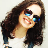Curly woman with sunglasses Royalty Free Stock Image