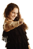 Curly woman with thumb up Stock Images