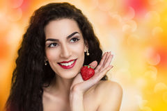 Curly woman. Young beautiful woman lady model woman,actress. Positive bright summer look. Chic impressive appearance. Perfect face, impressive makeup, eyebrows Royalty Free Stock Photo