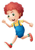 A curly young boy running Royalty Free Stock Photography