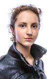 Curly young woman in black jacket Stock Images