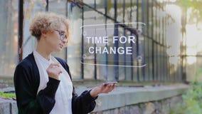 Blonde uses hologram Time for change