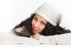 Curly young woman smiling. On white background Stock Photos