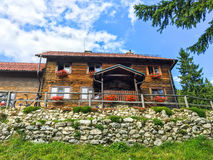 Curmatura refuge house. Romania. The famous Curmatura cottage refuge house in Piatra Craiului, mountain of Transylvania,  in Zarnesti, Romania Stock Image