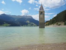 Curon, Italy. View of the old bell tower of the village rising out of the waters lake of Resia stock images