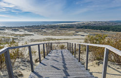 The Curonian Spit, Lithuania. The Curonian Spit stretches from the Sambian Peninsula on the south to its northern tip next to a narrow strait, across which Royalty Free Stock Image